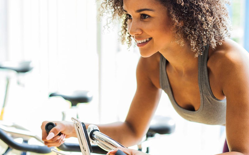 woman exercising on a stationary bicycle