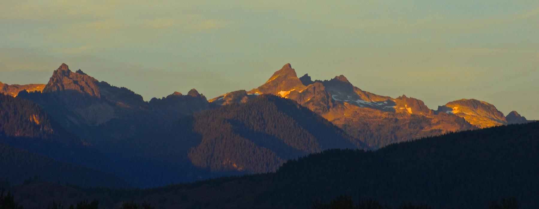 mountain range against a blue sky